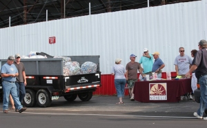 Fans donate aluminum cans at Oswego Speedway
