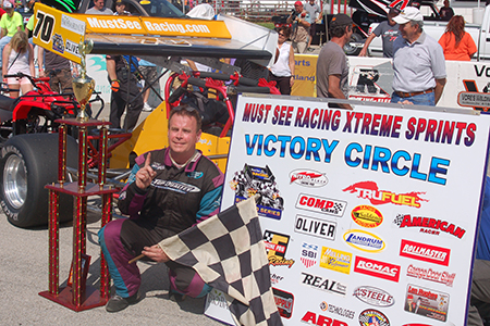 Dave McKnight, Jr. claimed the fame of winning at Winchester Speedway in Must See Racing go. Photo by RG Design