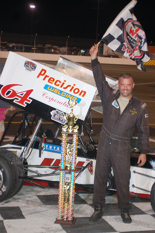 Jim Paller waves checkered flag after Must See Racing win