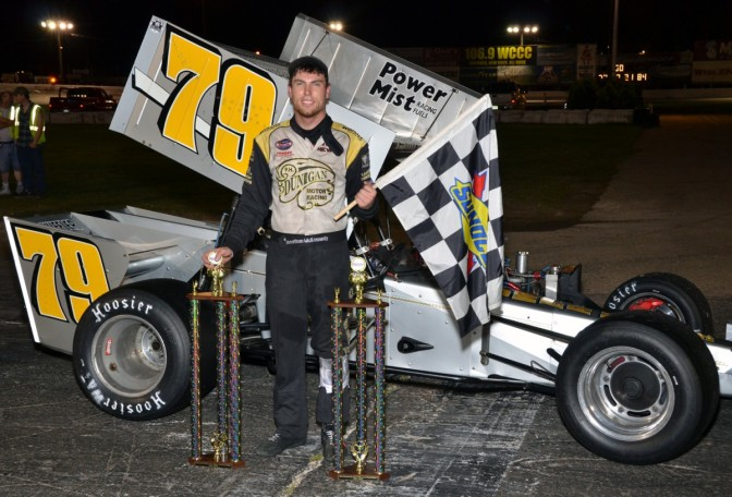 Jon McKennedy poses in Waterford Speedbowl victory lane after ISMA win.