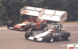 Howie Page and Garry Evans go side by side at Kalamazoo Speedway.