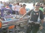 Joey Payne poses with Strong Racing supermodified at Oswego Speedway