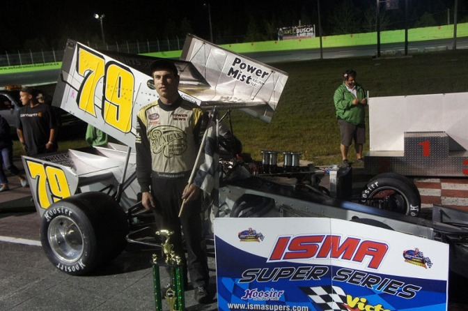 Jon McKennedy poses in Autdrome Chaudiere victory lane after ISMA supermodified win