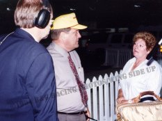 Dave Despain Lex Dudas and Shirley Letcher discuss the 1994 ISMA exhibition at Indianapolis Raceway Park