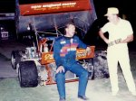 Dave Simard sits on his car at Sandusky Speedway