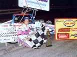 Jim Shirey poses with trophy after 1994 ISMA Hy-Miler Supermodified Nationals win at Sandusky Speedway.
