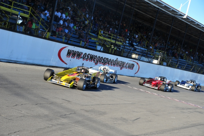 supermodifieds race down front stretch at Oswego Speedway