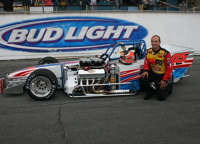 Bobby Santos III poses with supermodified at Oswego Speedway International Classic Photo by Mike Johnson