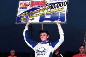 David Danzer holds Oswego Speedway Mr Supermodified check