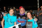 Joey Payne flanked by Oswego Speedway trophy girls after win august 9 2014
