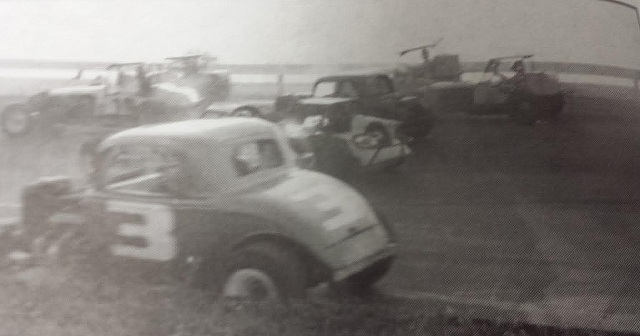 Cars pile up in the first turn at Oswego Speedway at start of 1962 International Classic