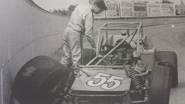 Kenny Andrews looks dejectedly at his wrecked supermodified after crashing at Oswego Speedway International Classic practice in 1973