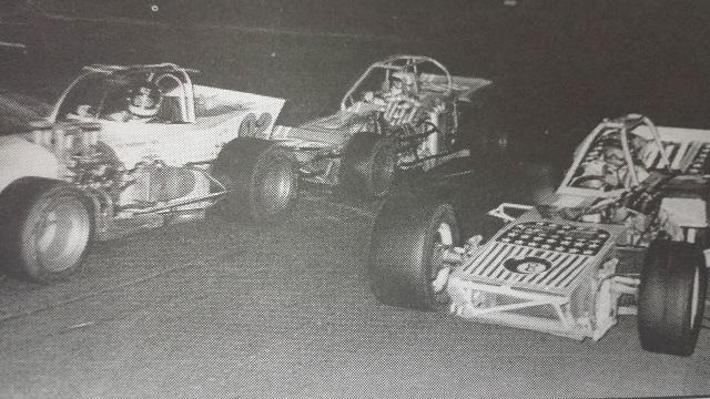Jim Shampine passes Bobby Stelter at 1974 Oswego Speedway International Classic by Speedway Press