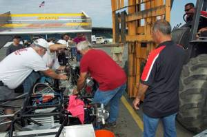 Ben Seitz and crew work to change blown engine at Oswego Speedway