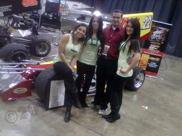 mike mcvetta poses with girls at piston power show