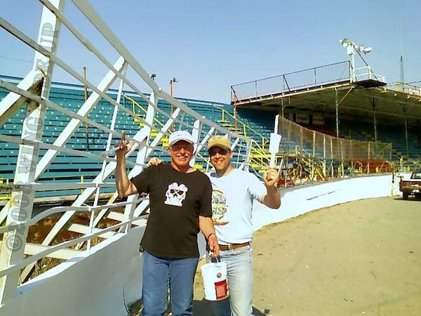 Jim Pasquin and Bob Gangwer slap paint on The Big O in 2008