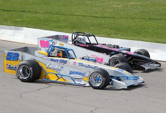 David Danzer passes Daniel Connors at Oswego Speedway open practice. Mike Johnson photo supplied