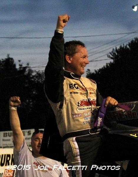 Tim Jedrezejek celebrates ISMA win at Oswego.