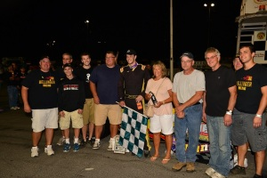 Brandon Bellinger is joined by family and crew after first oswego speedway win