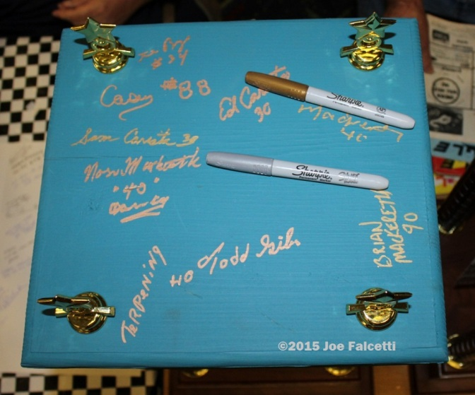the trophy for the oswego speedway 65th anniversary race was signed by many supermodified legends